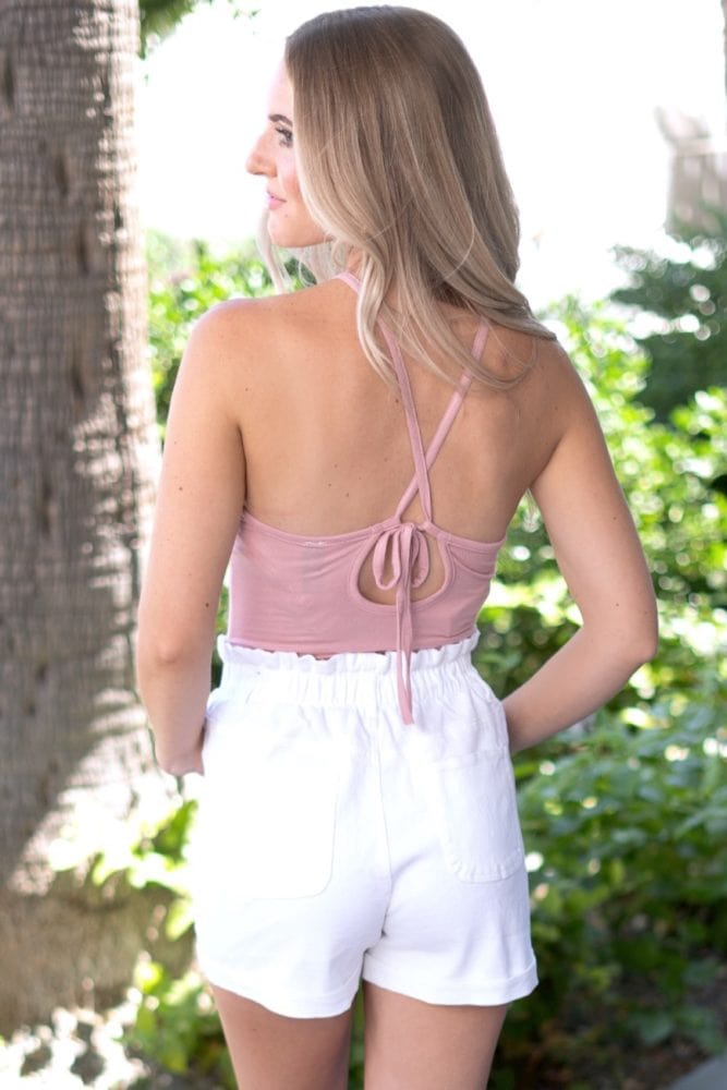 sleeveless pink bodysuit