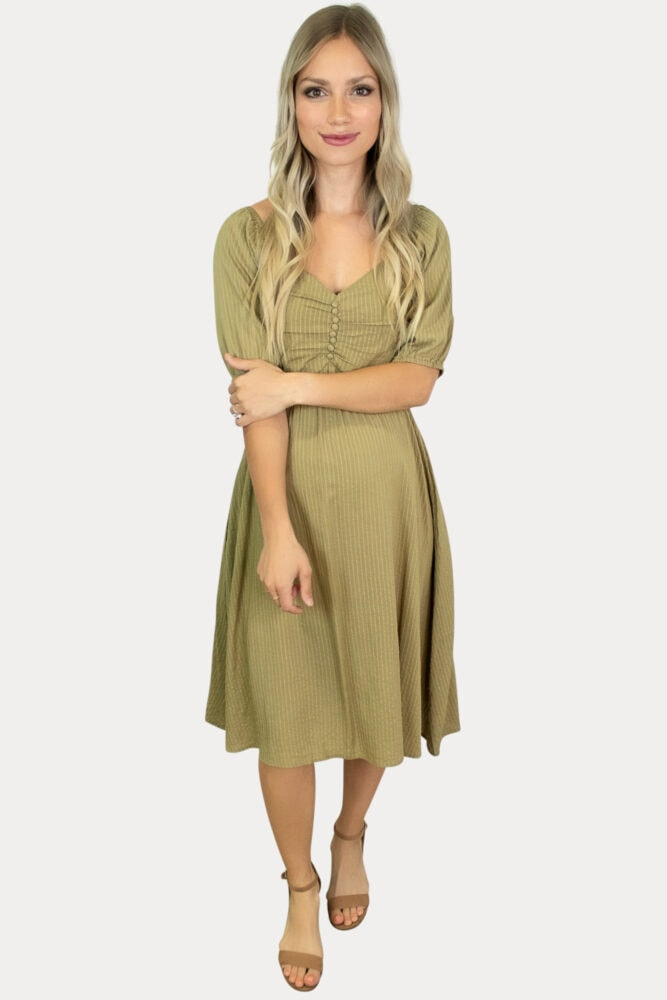 Our striped button down maternity dress in olive is sure to add a subtle elegance to your mama wardrobe!